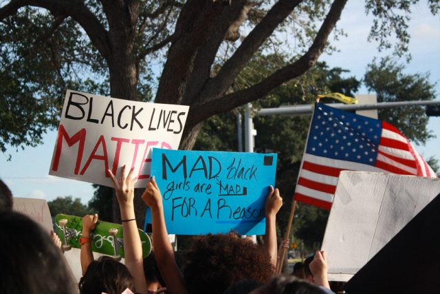 Black Lives Matter protestors hold up signs outside of McAllen City Hall.
