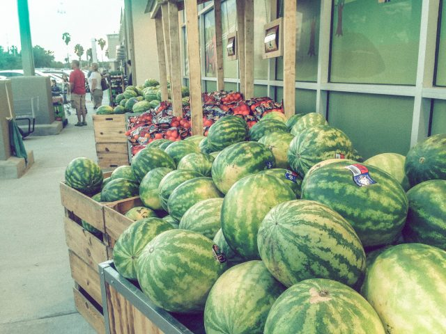 Heaps of watermelons and fresh potted plants greet you at the entrance to the new Sprouts store